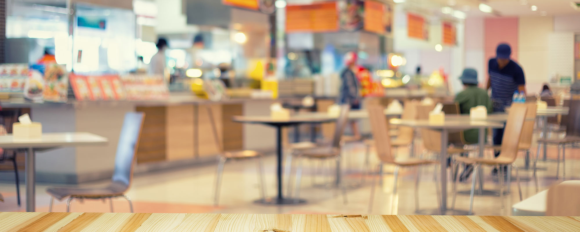 blurred image of check-outs at a grocery store