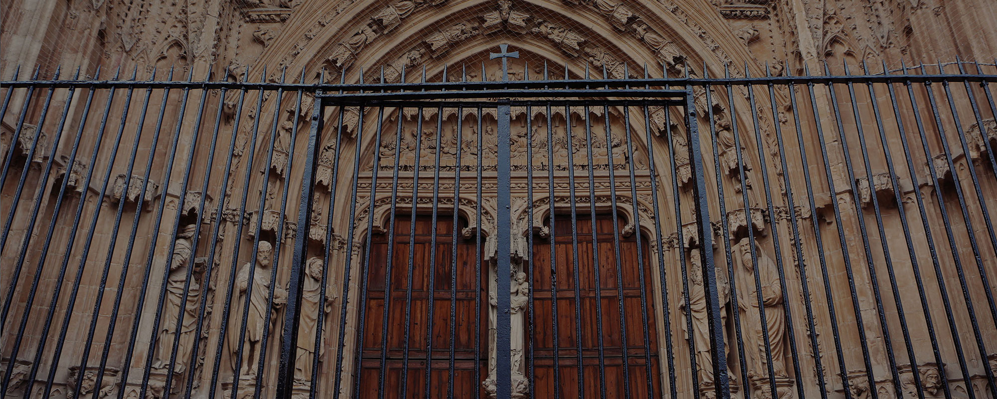 front of a church with closed gate