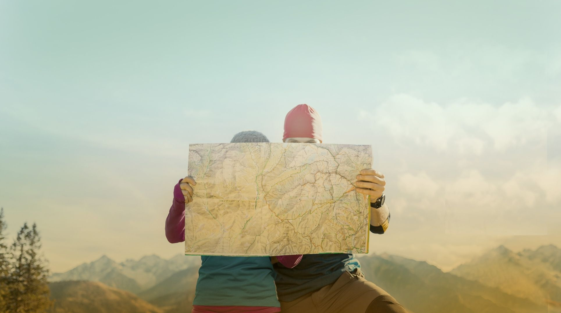 two hikers looking at a map